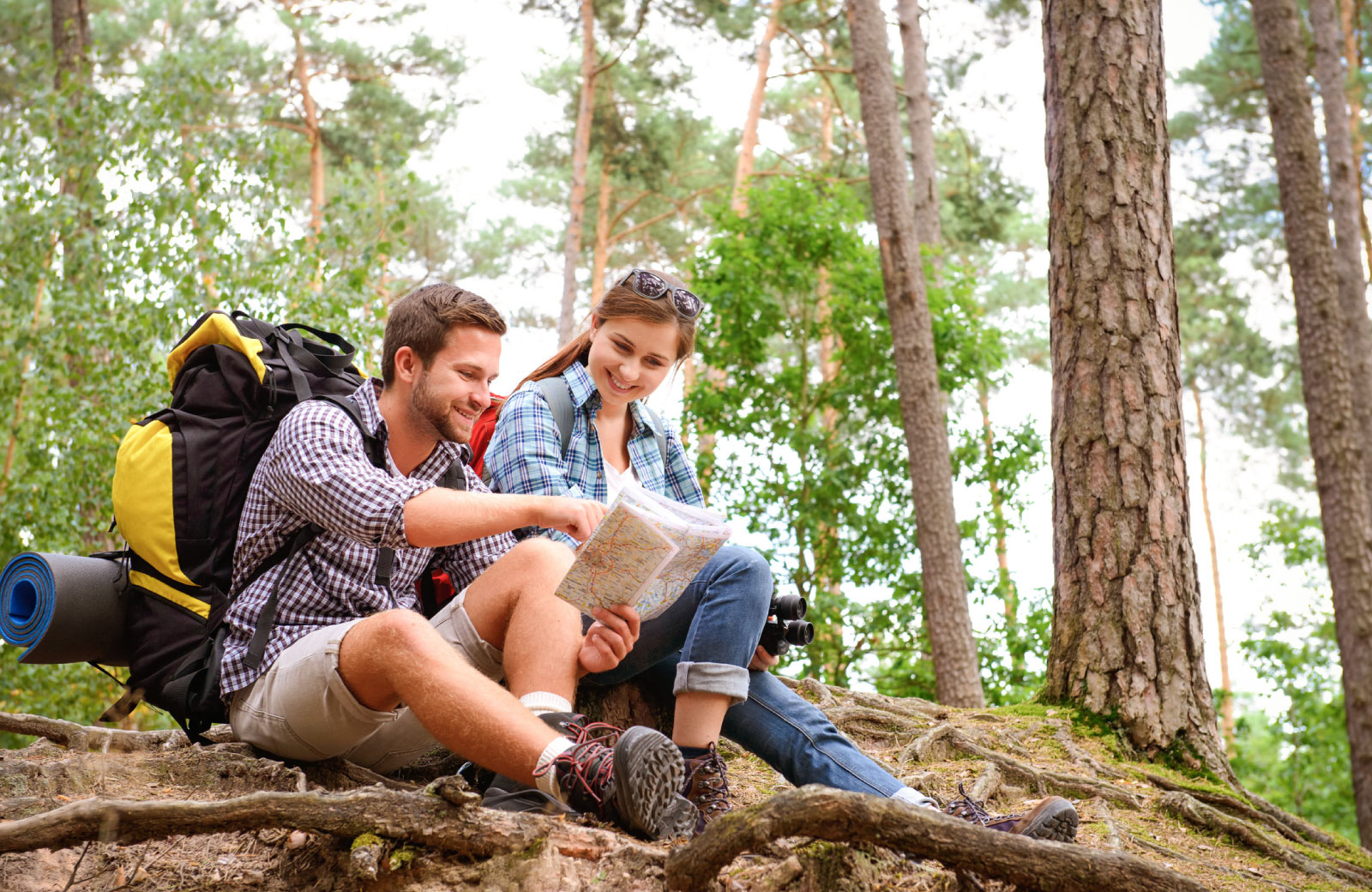 couple on a hike reading a map