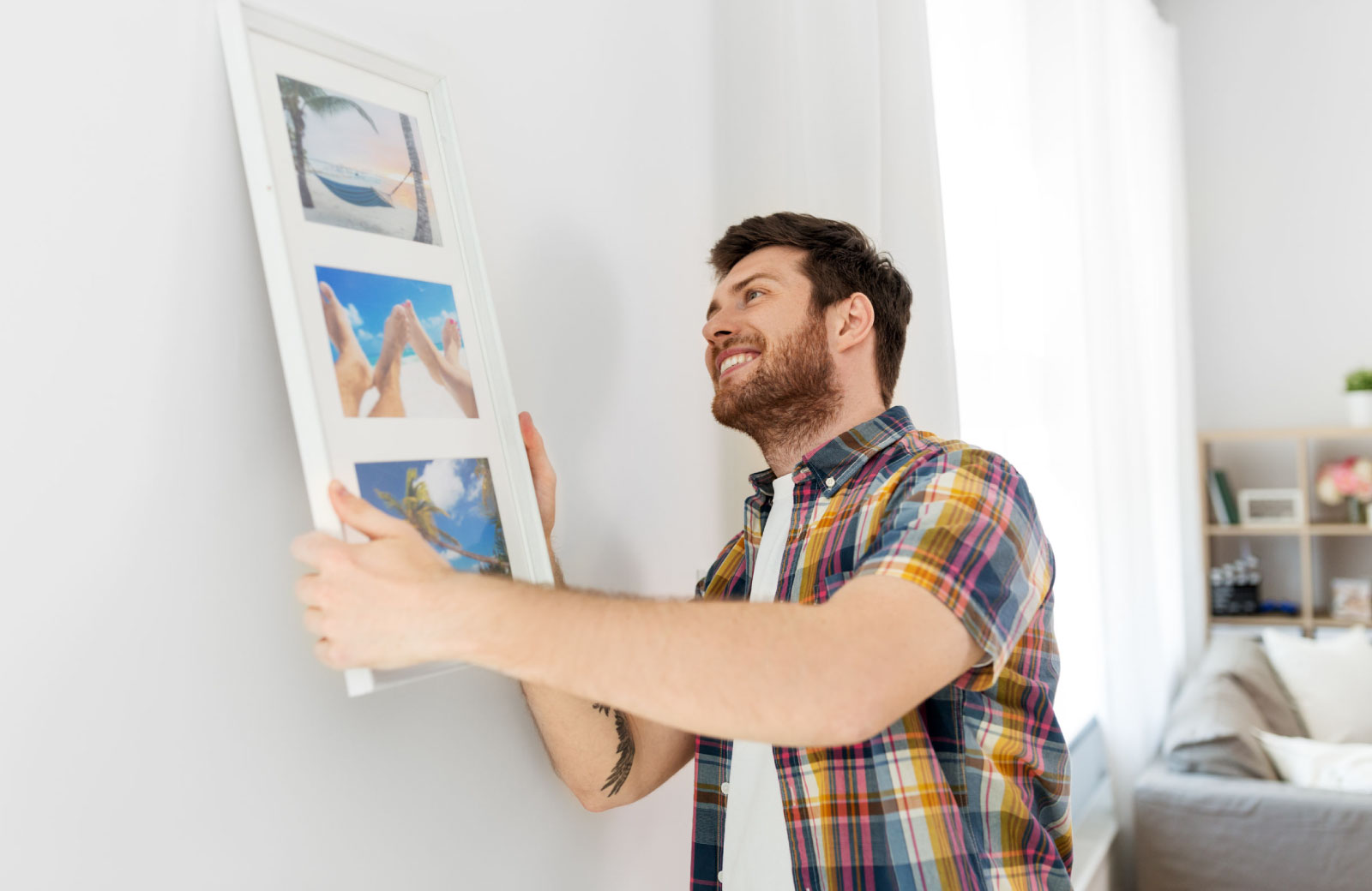man setting up house decor