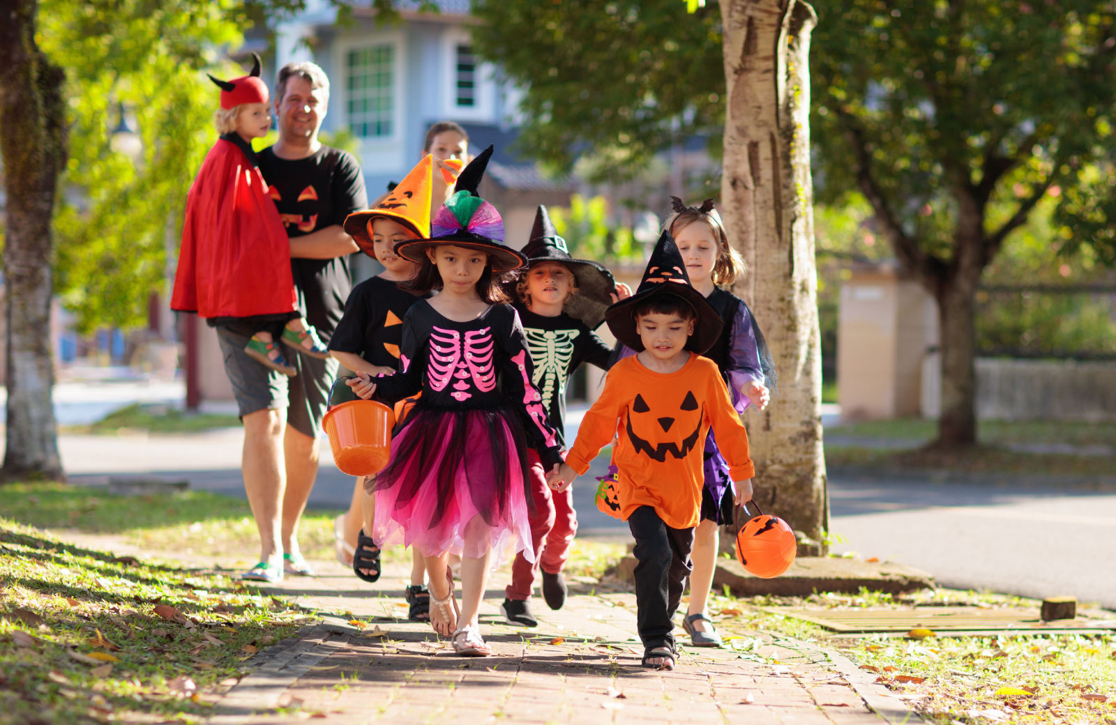 kids trick or treating with parents