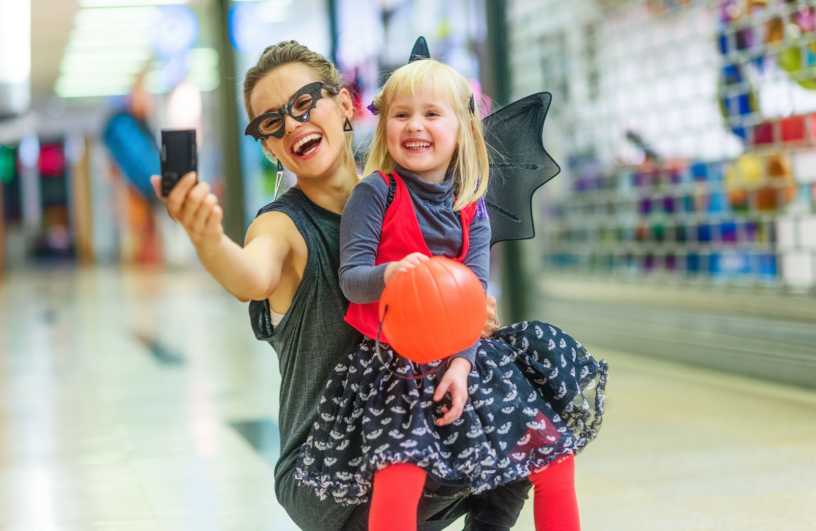 mother and daughter in halloween costumes taking a selfie