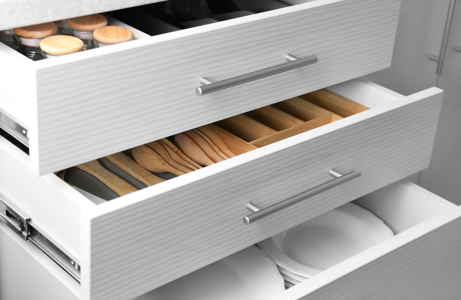 kitchen drawer full of eating utensils