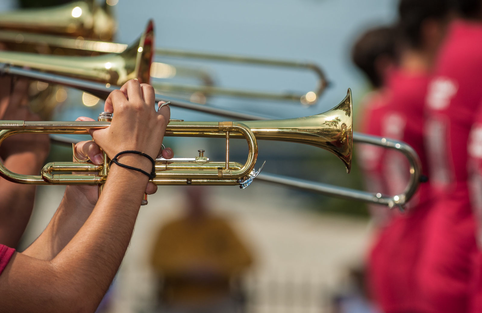people playing trumpets in a marching band
