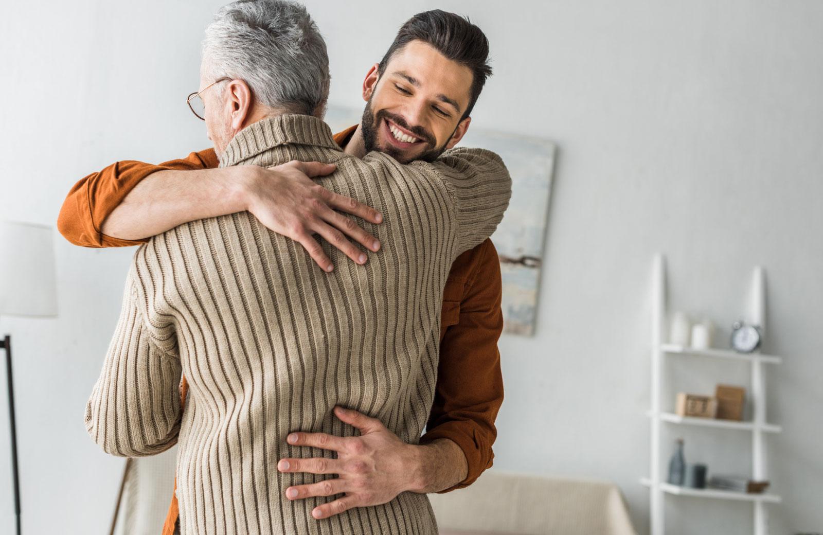 man embracing an older man