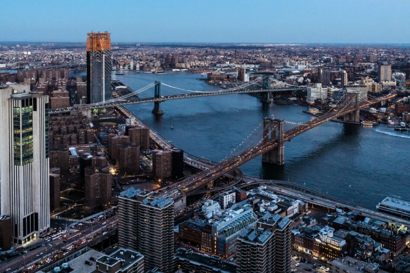 aerial view of the brooklyn bridge in NYC - high rise apts financial district