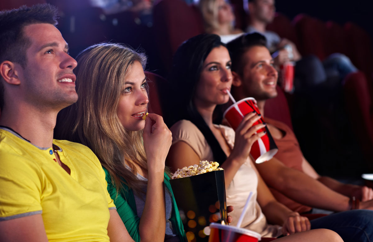 4 friends at a movie theatre - The Madrid Westchester LA Neighborhood