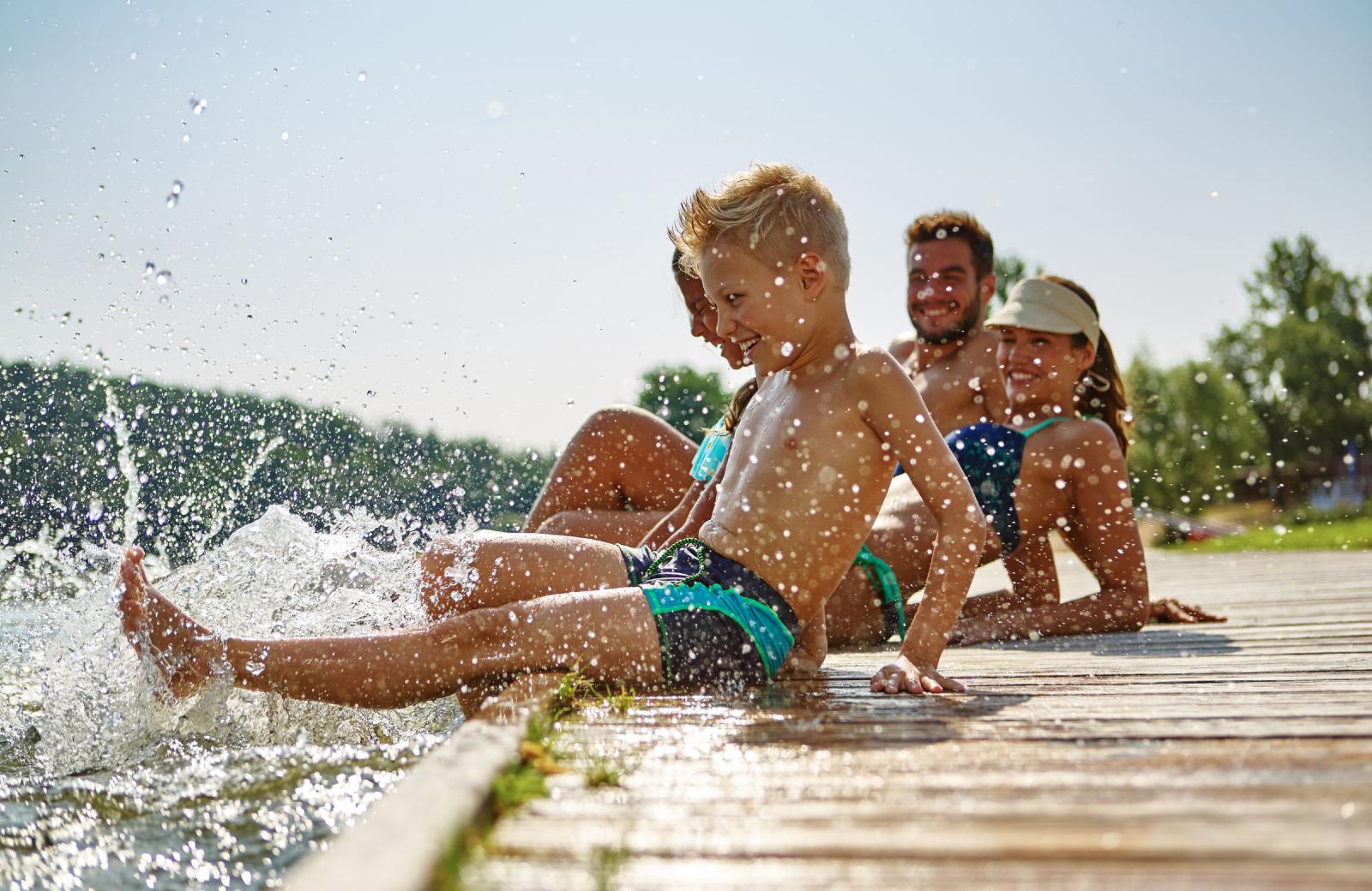 Kids Enjoying Shoreline Lake - The Village Residences Apartments