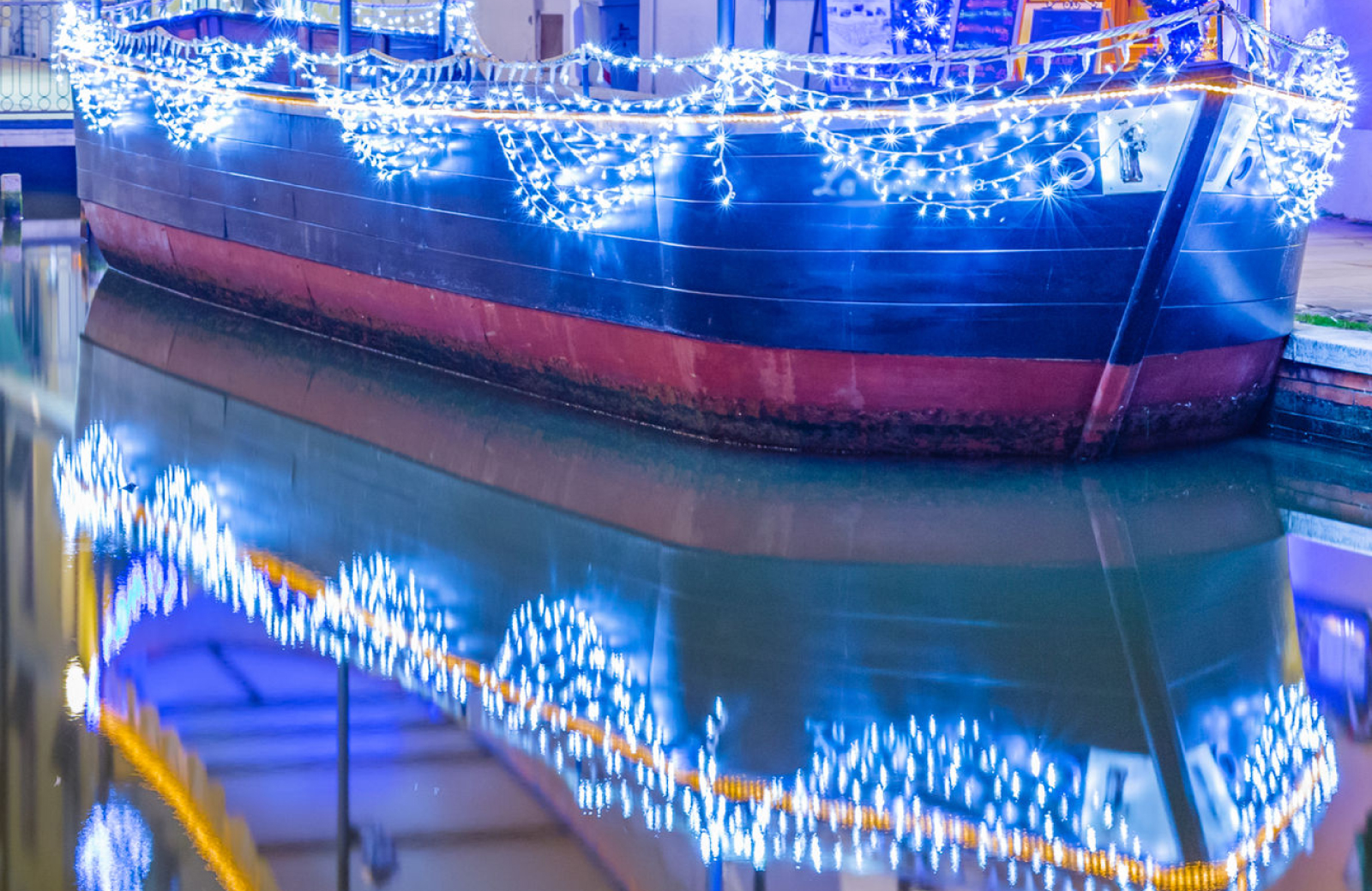 Boat decked out in blue holiday lights - The Vue