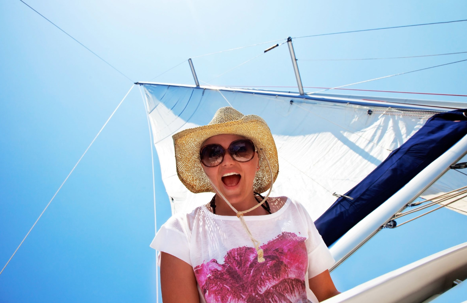 happy woman on a sailboat - sweetheart sail - the Vue