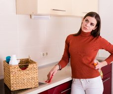 woman cleaning kitchen Upper East