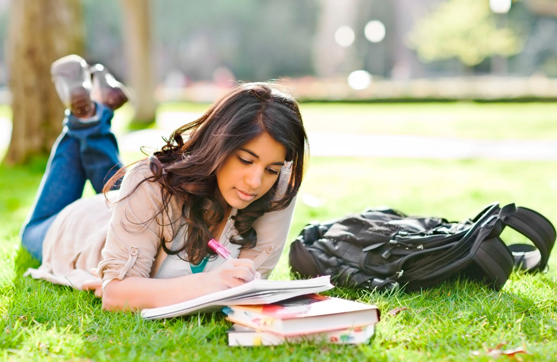 female student studying on the field
