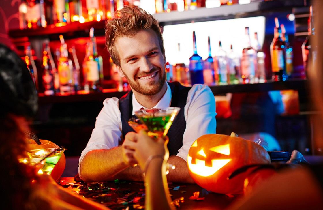 man enjoying his drink in a bar west village davis