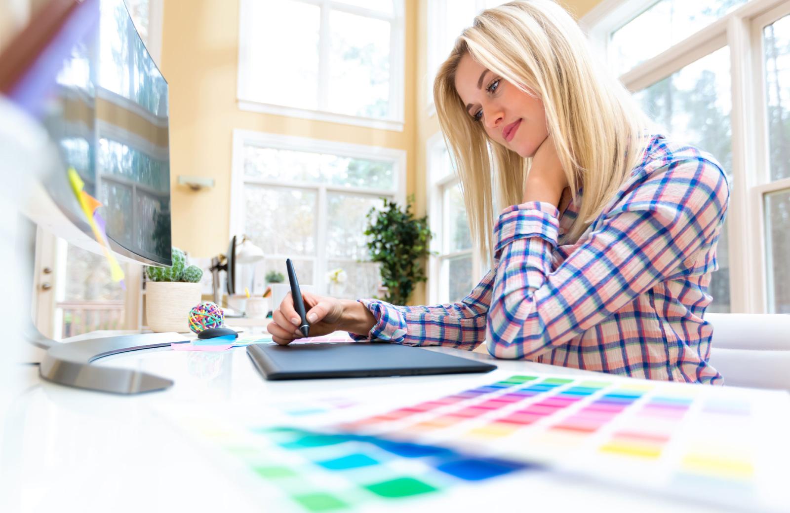 female student sketching some designs west village davis