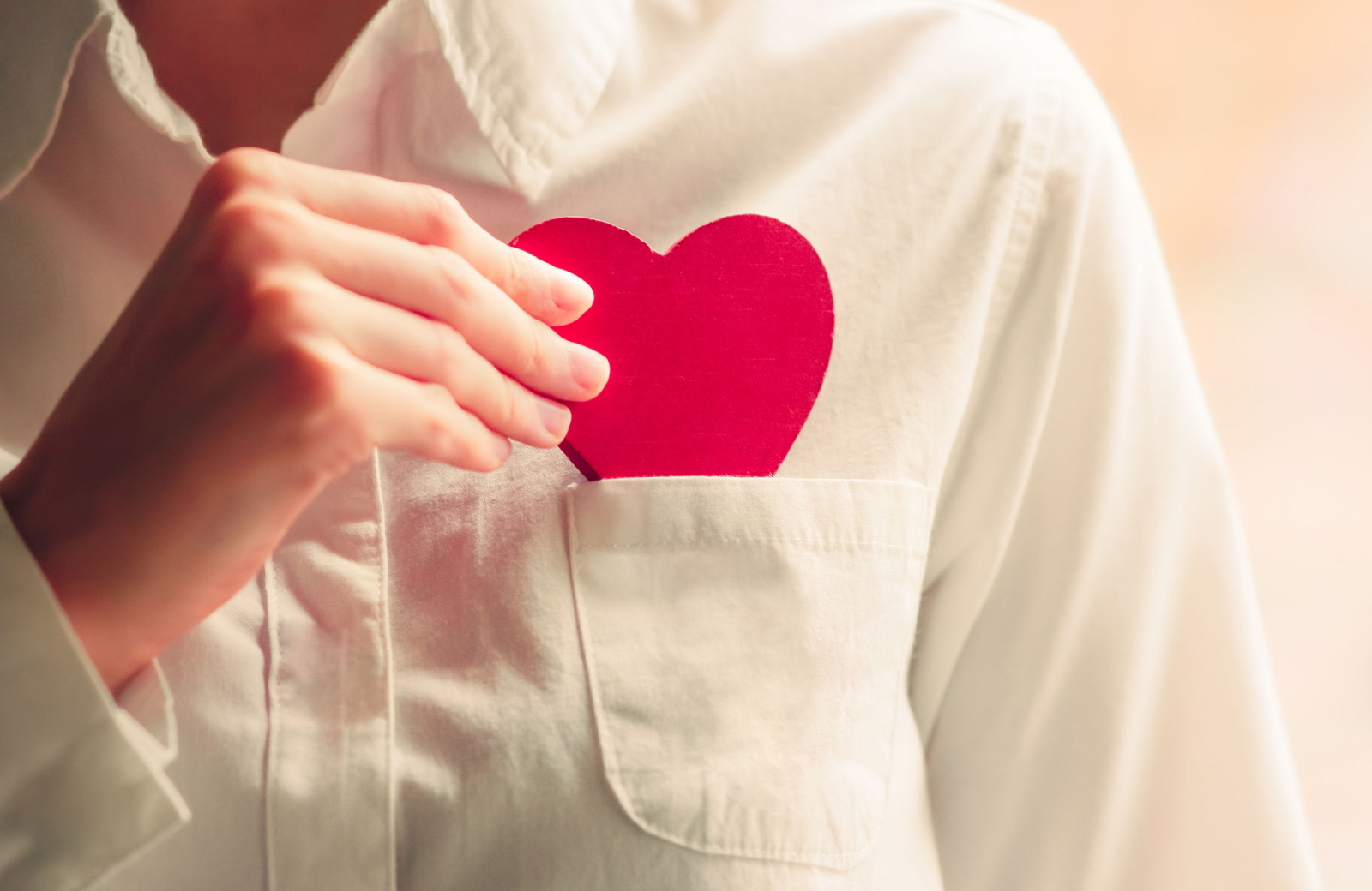 man putting a heart cut out in his shirt pocket west village davis