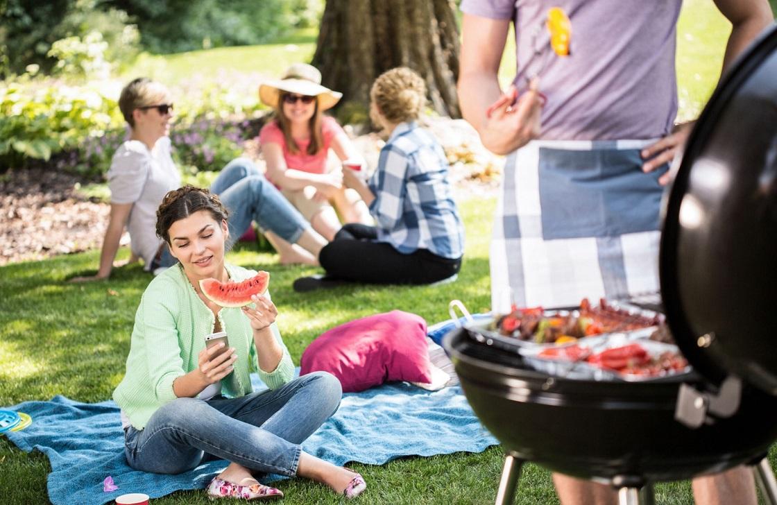 young woman enjoying a watermelon on a picnic west village davis, ca