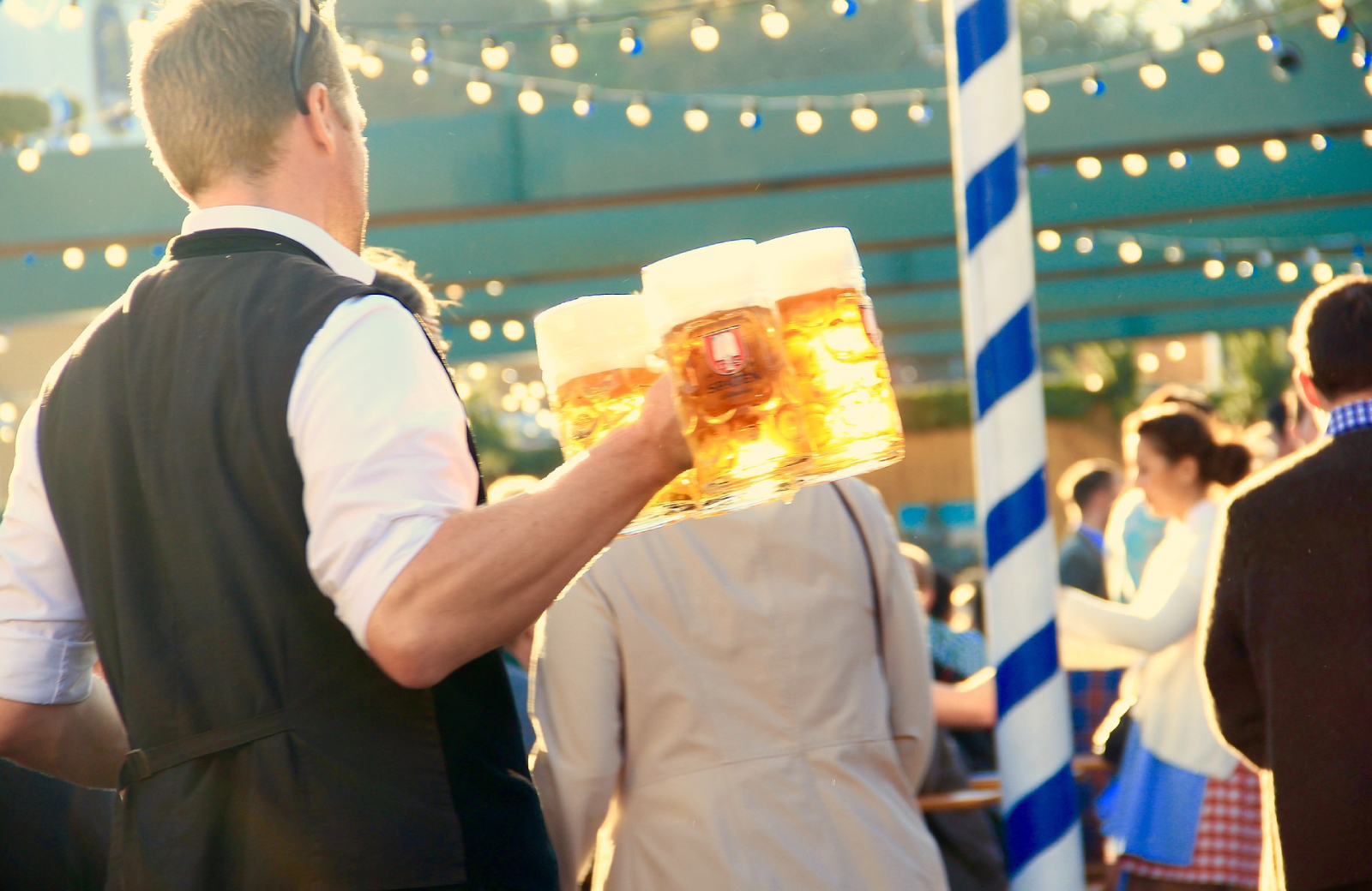 guy in a black vest carrying several beers at octoberfest celebration in nyc - 15 cliff