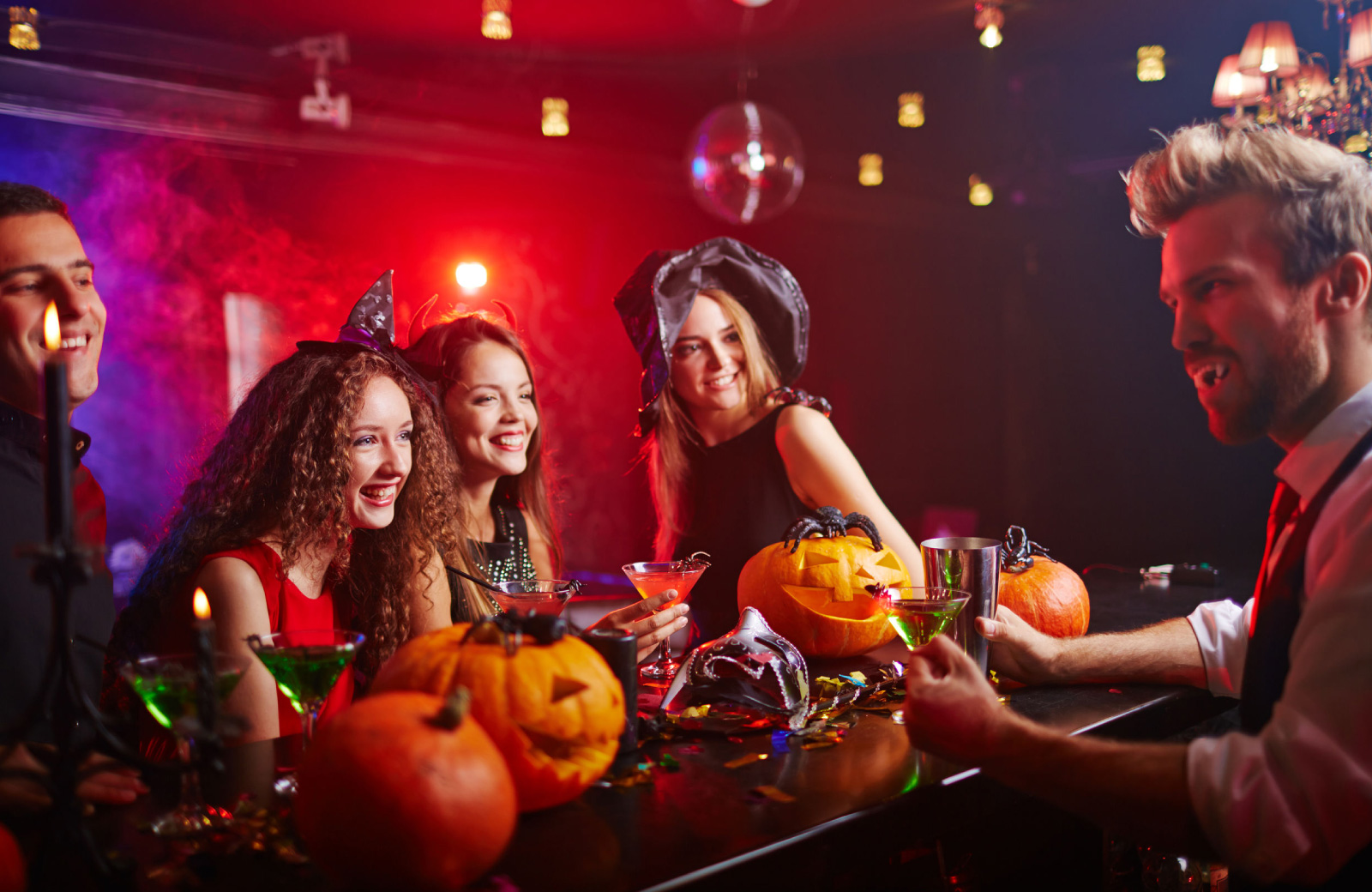 group of girls partying at a bar during halloween colab denver