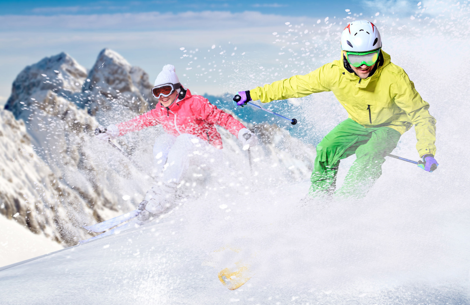 couple skiing down the slopes