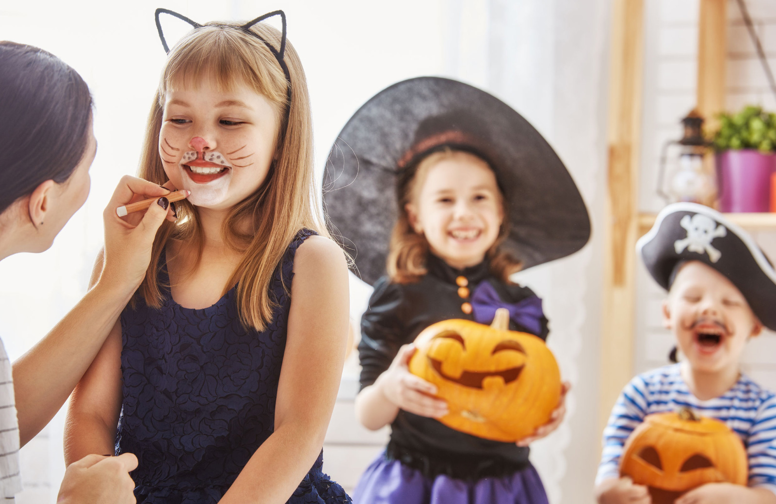 little girls in cat costume & witch costume getting ready for trick or treat - hyde square bellevue