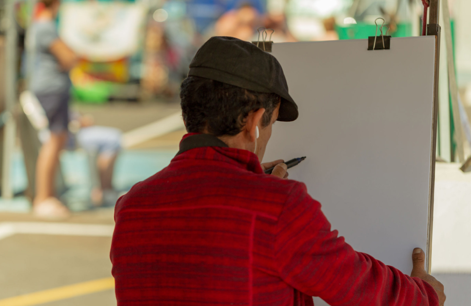 artist drawing on a canvas hyde square bellevue wa