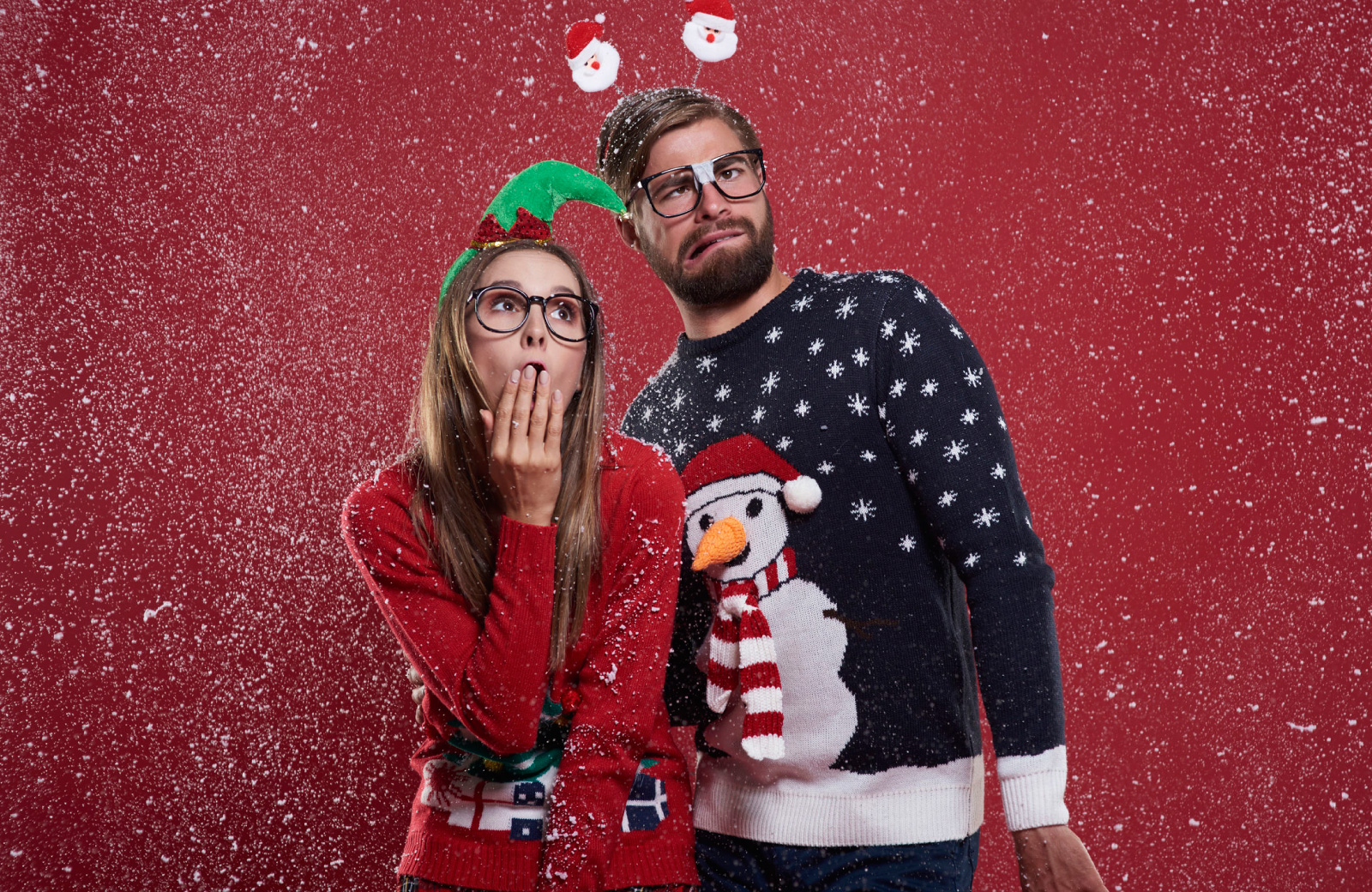 Couple wearing holiday sweaters Pleasanton, CA vintage apartments