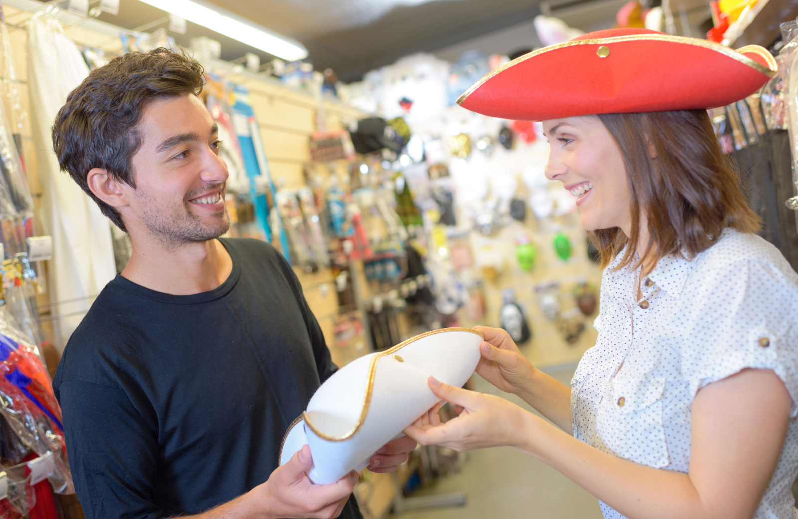 couple in a costume store trying on hats - the madrid LA