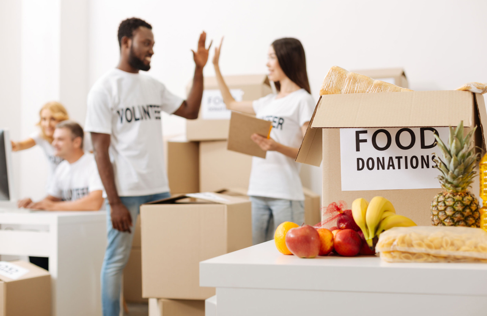 volunteers in a food donation drive the henry apartments