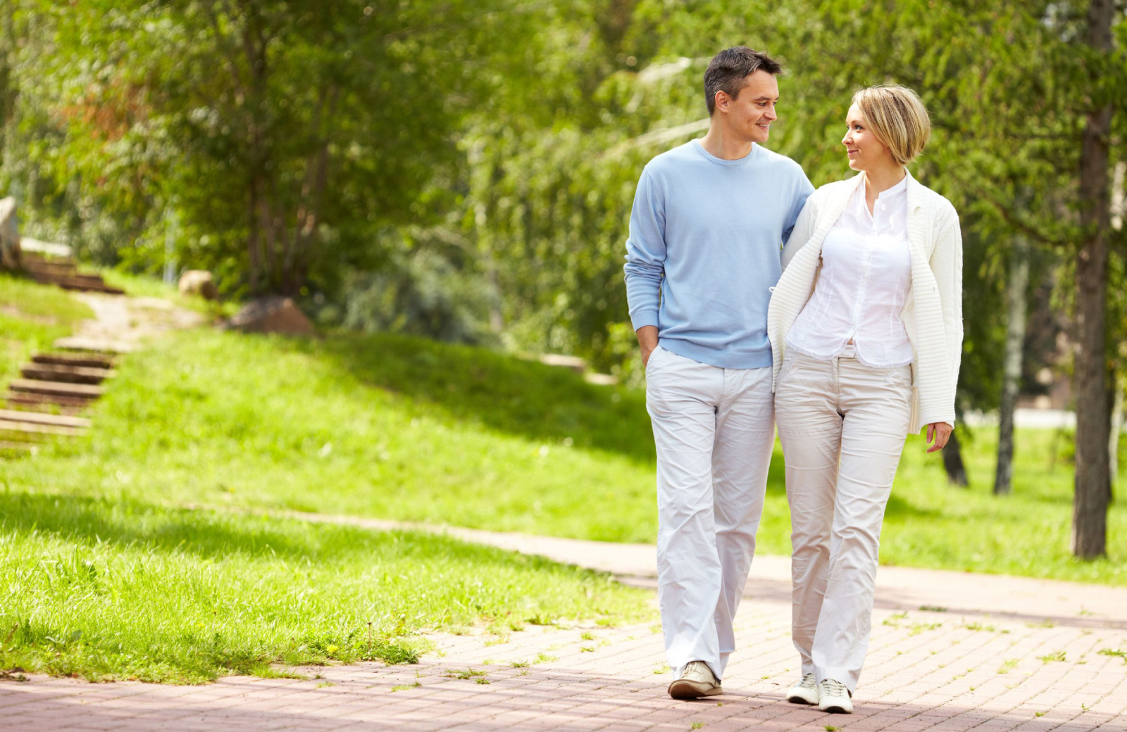 couple strolling in a park altana glendale