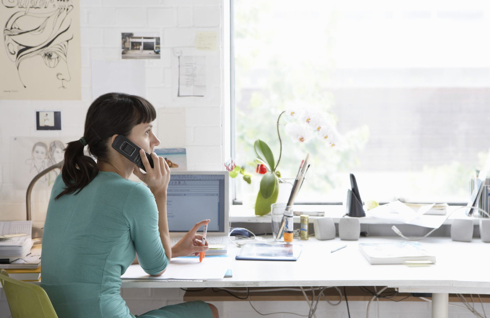 woman on the phone in her home office