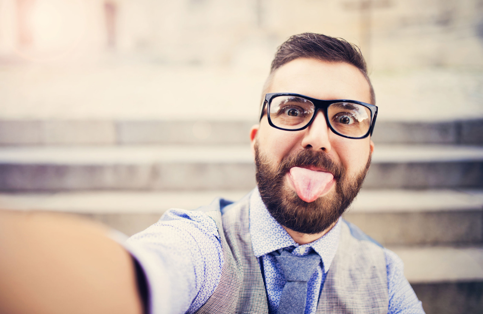 man with glasses and beard taking a selfie altana glendale