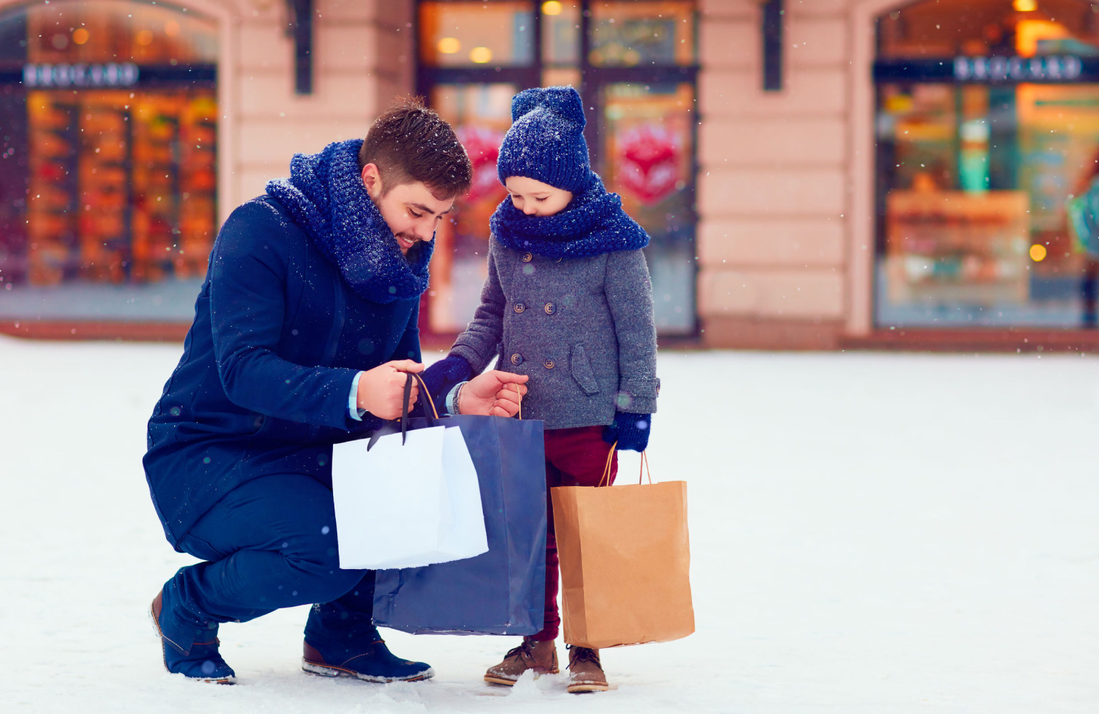 man and child in winter coats