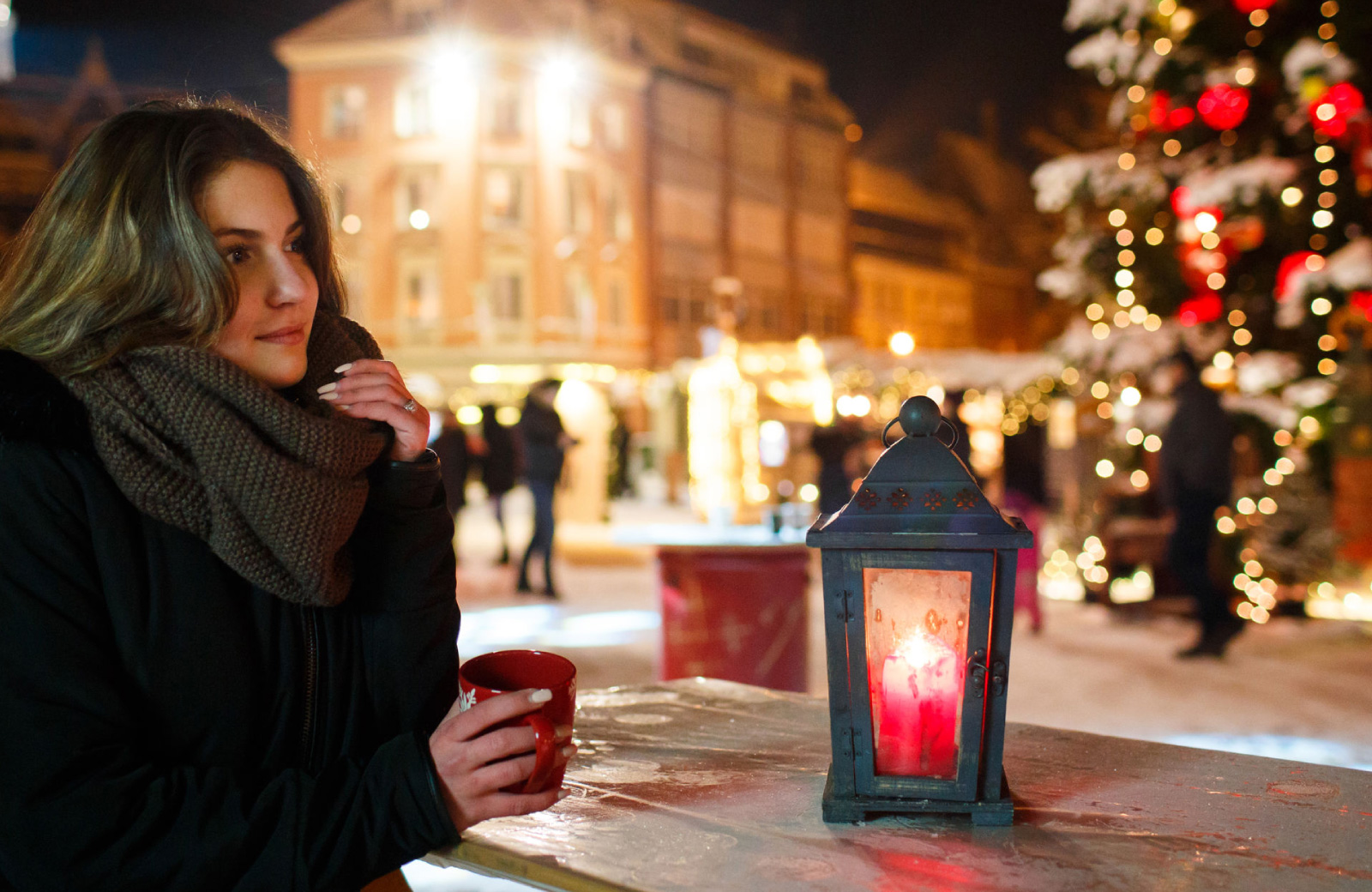 woman in winter clothes enjoying a hot drink