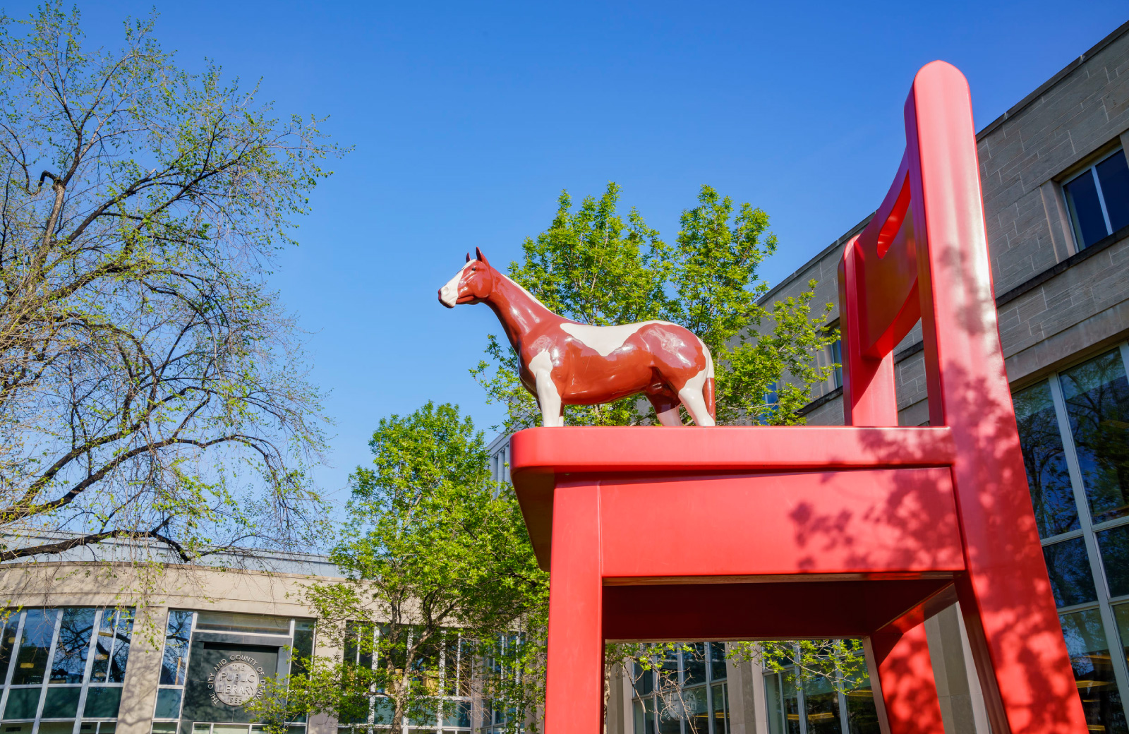 big red chair with horse colab