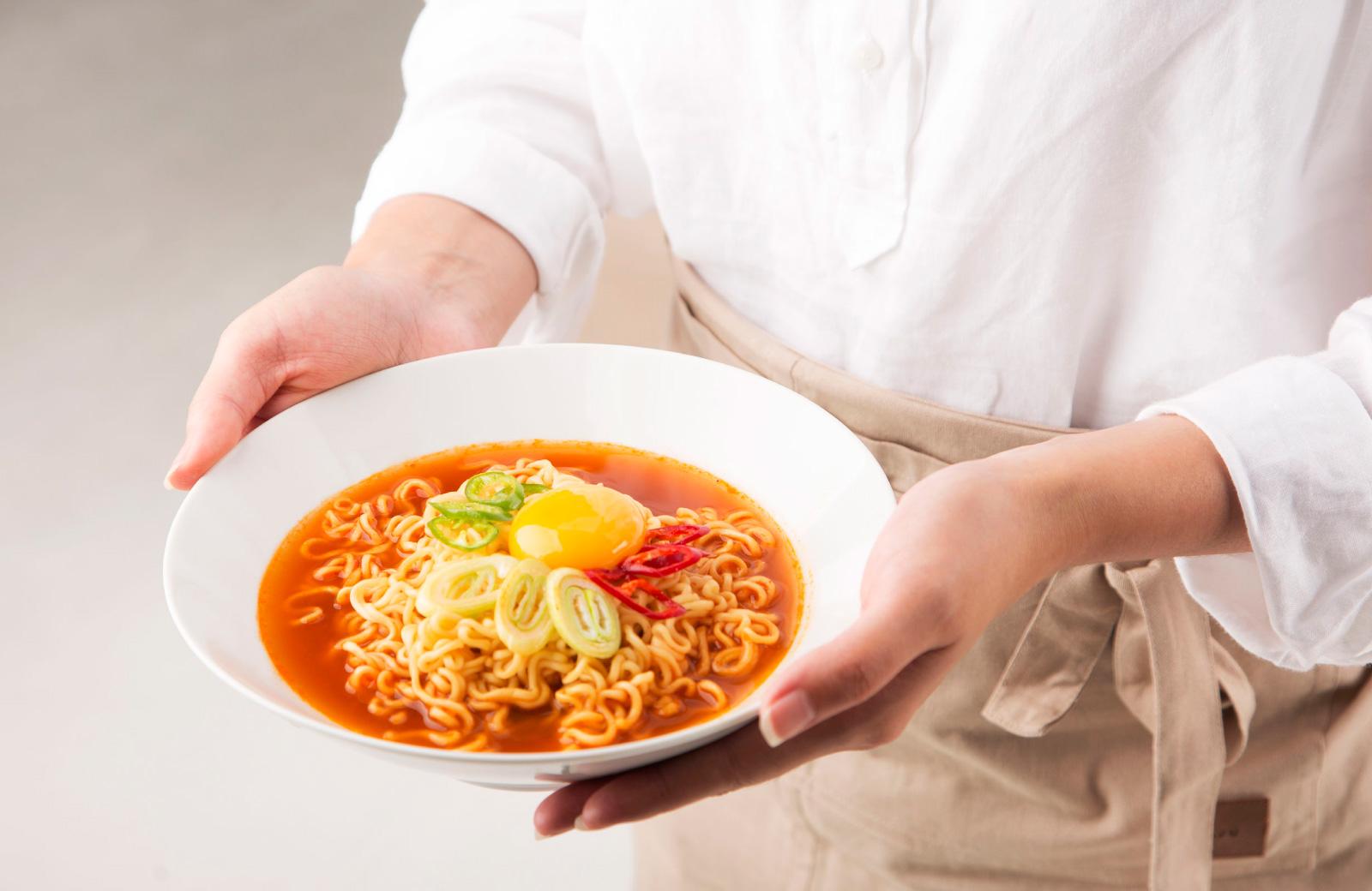 chef presenting ramen