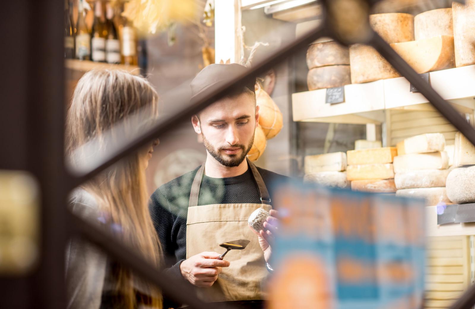 people examining cheese