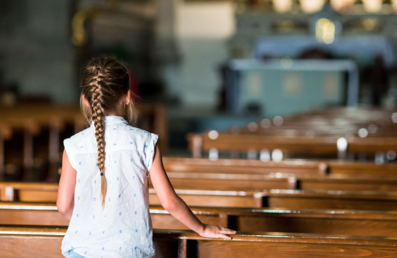 little girl inside a church