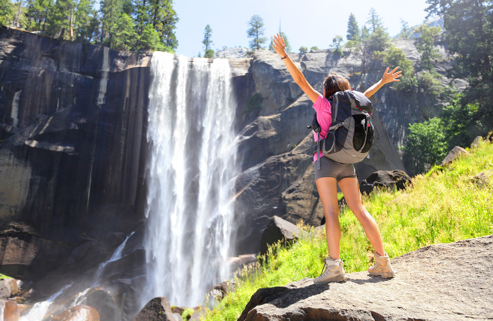 woman hiking in yosemite in front of a waterfall - The Madrid apts in LA