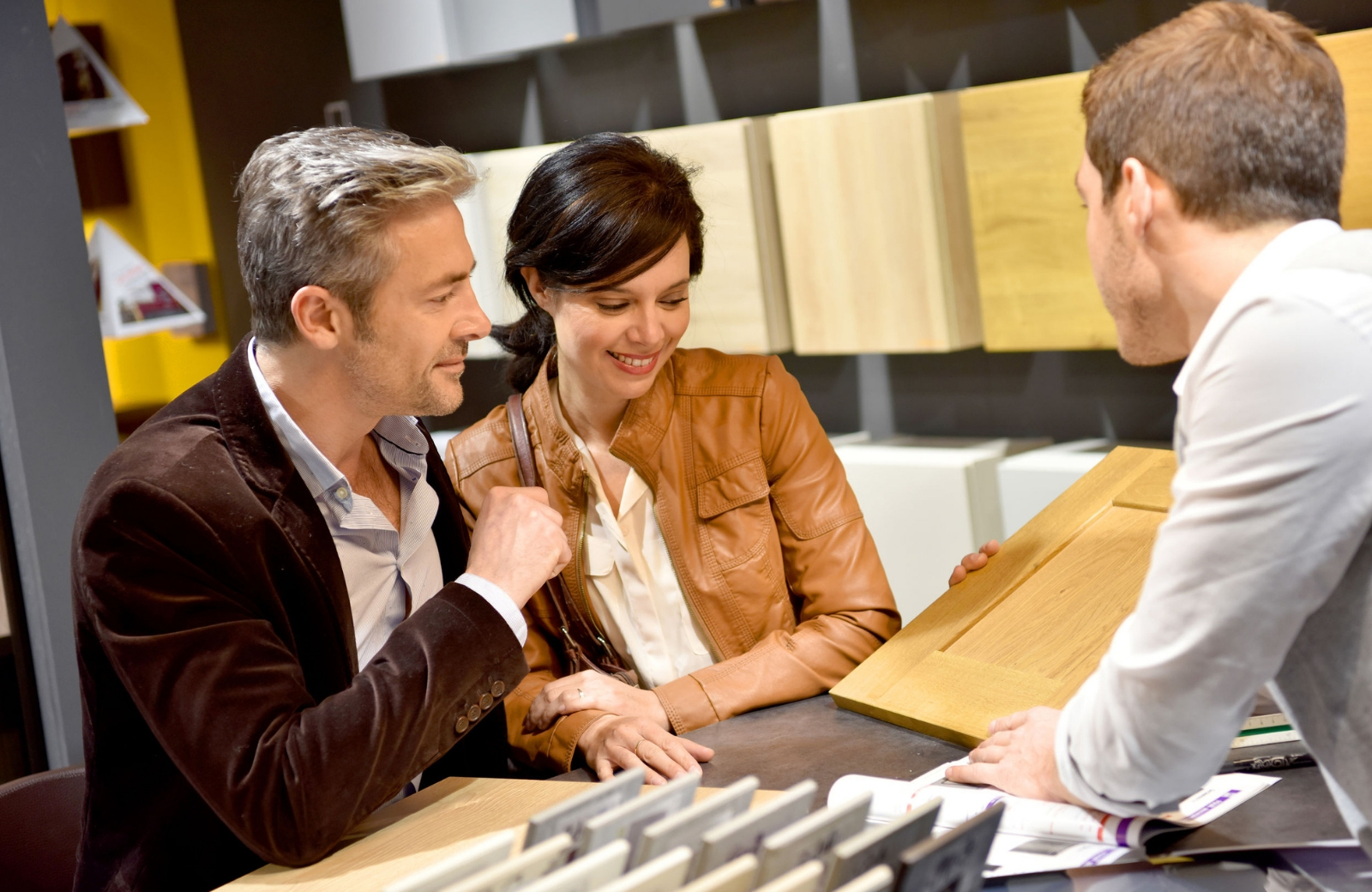 couple with salesman in furniture shop