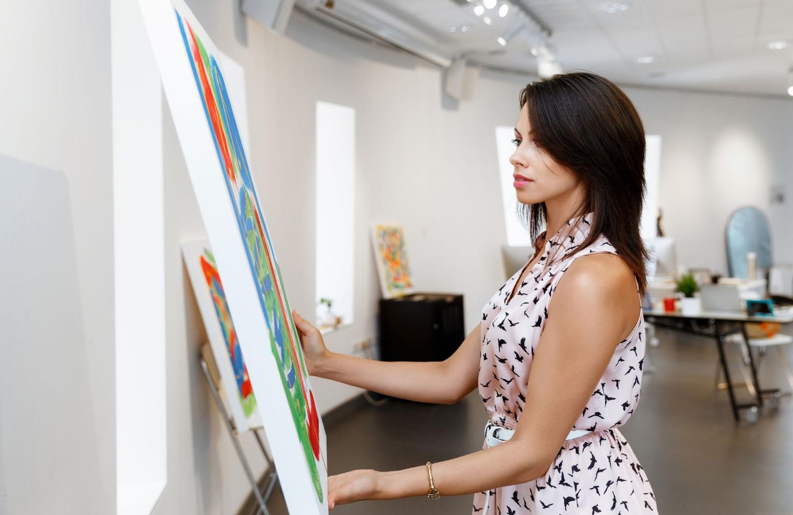 woman examining a painting