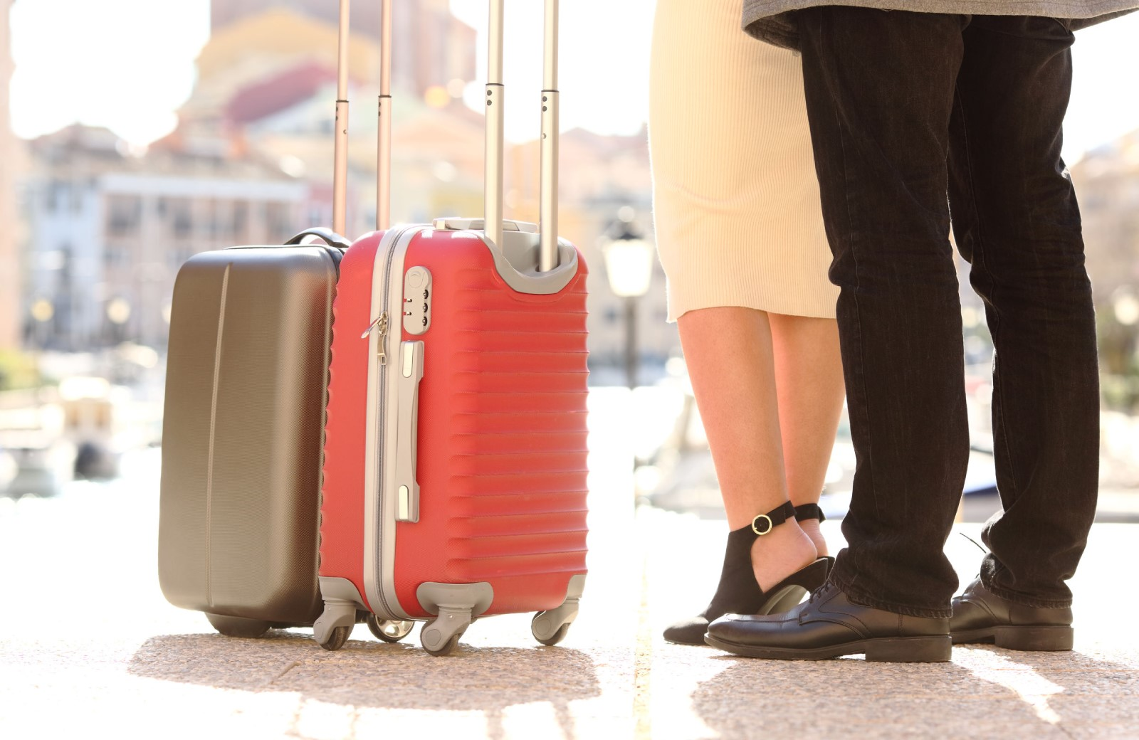 couple with travel luggage