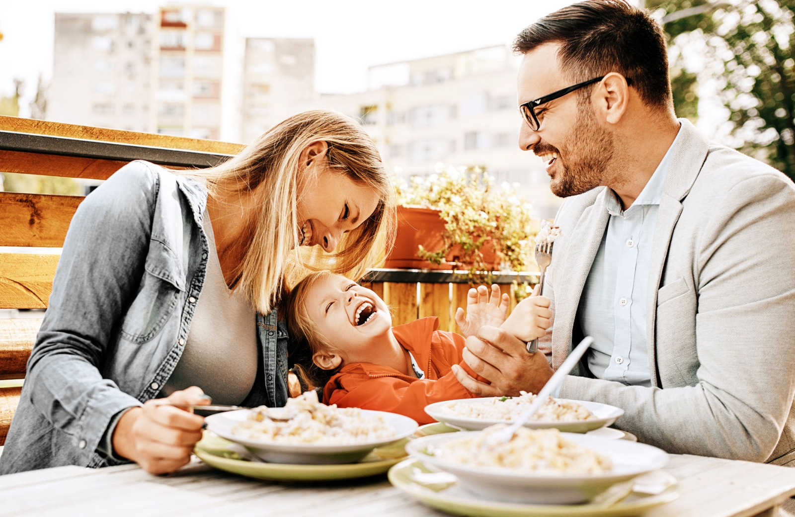 family of three dining in restaurant