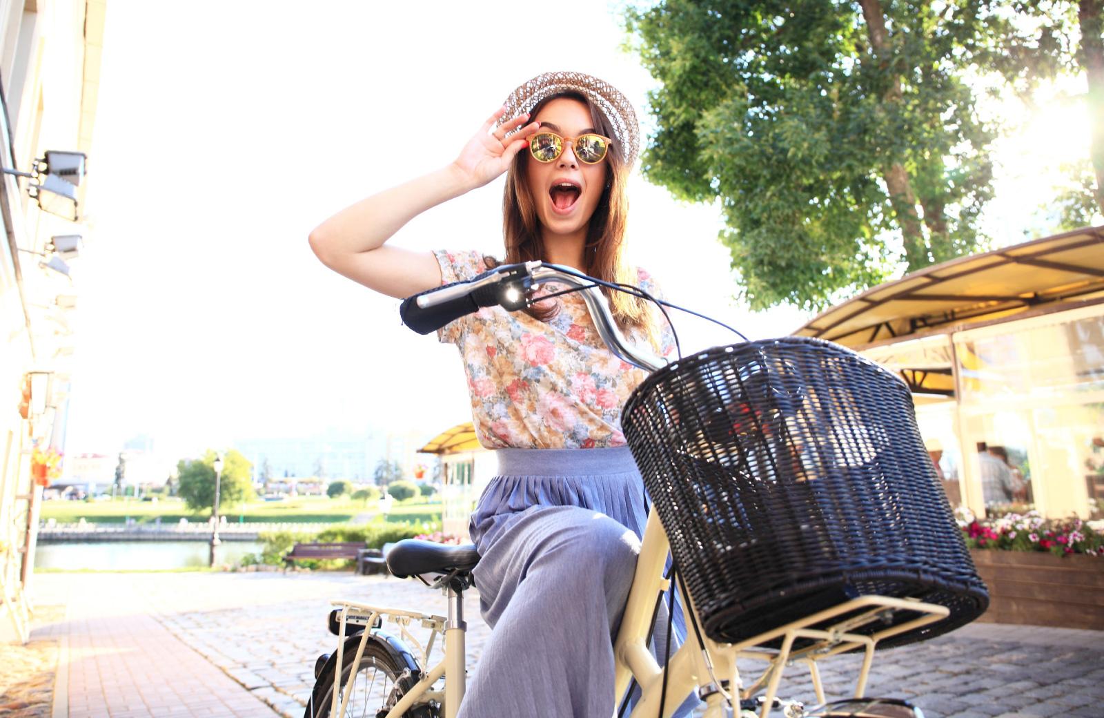 girl on a bike with basket