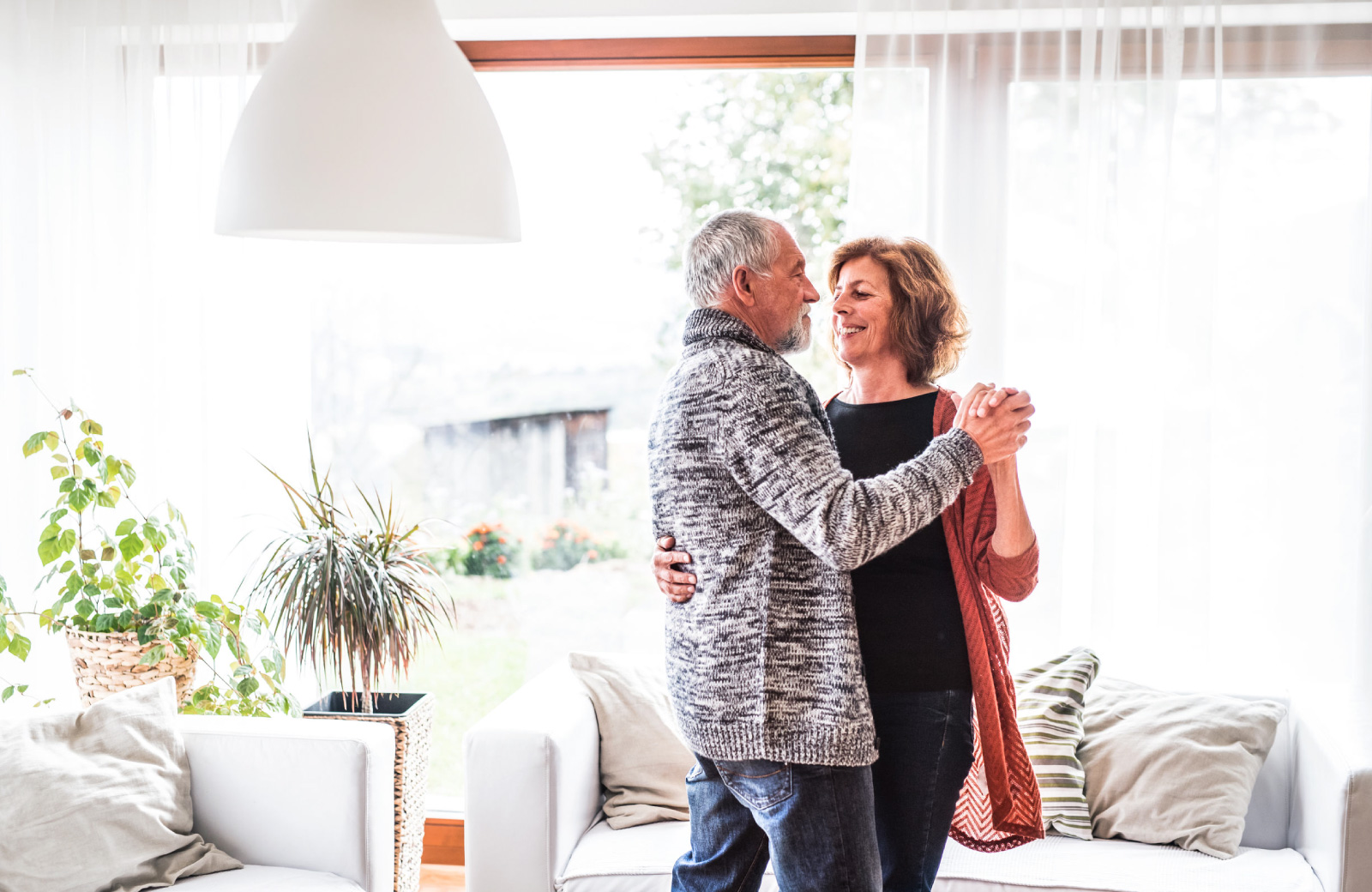 mature couple sweet dancing in the living room - The Madrid apts in Westchester LA