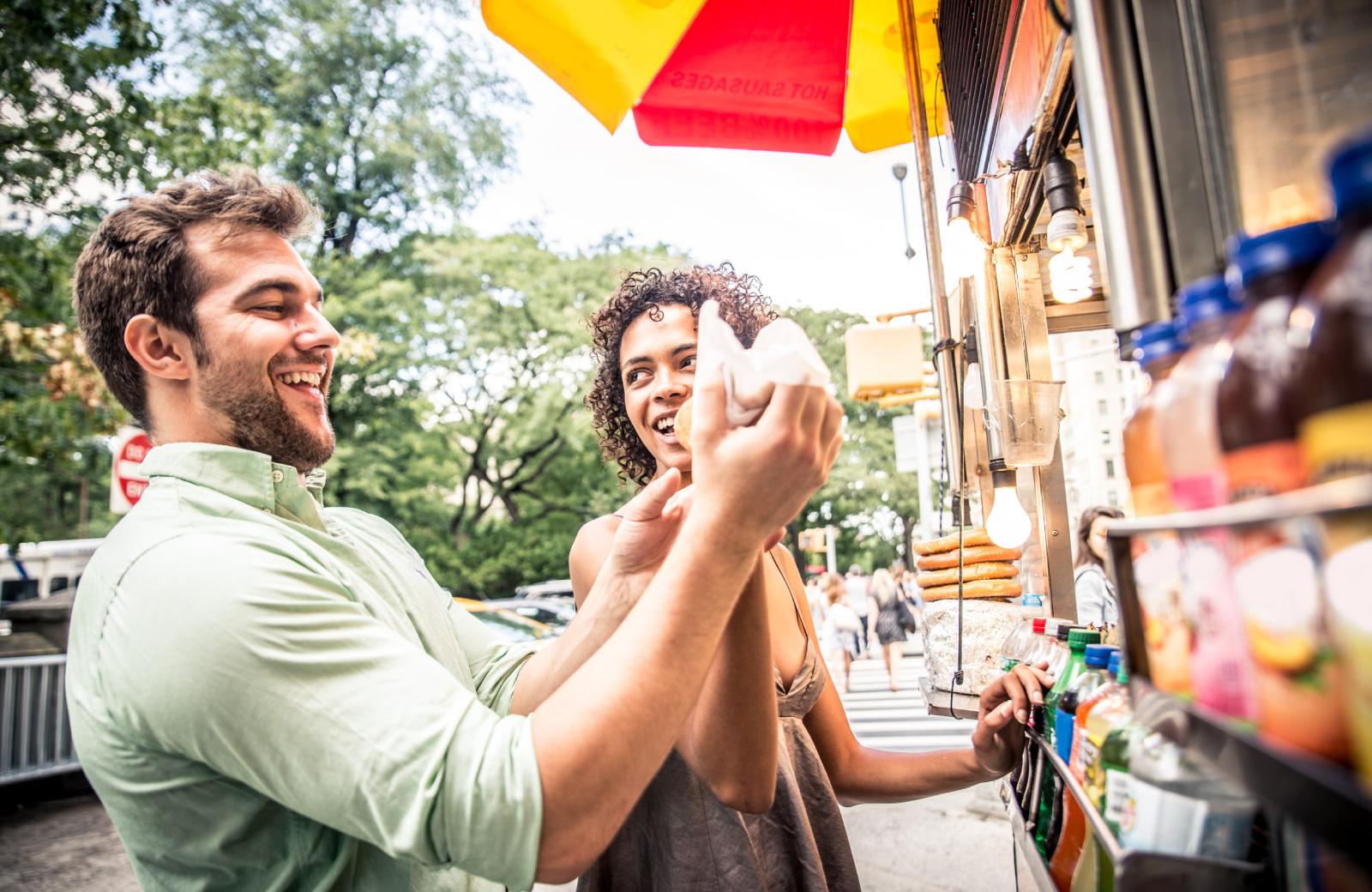 couple sampling street food