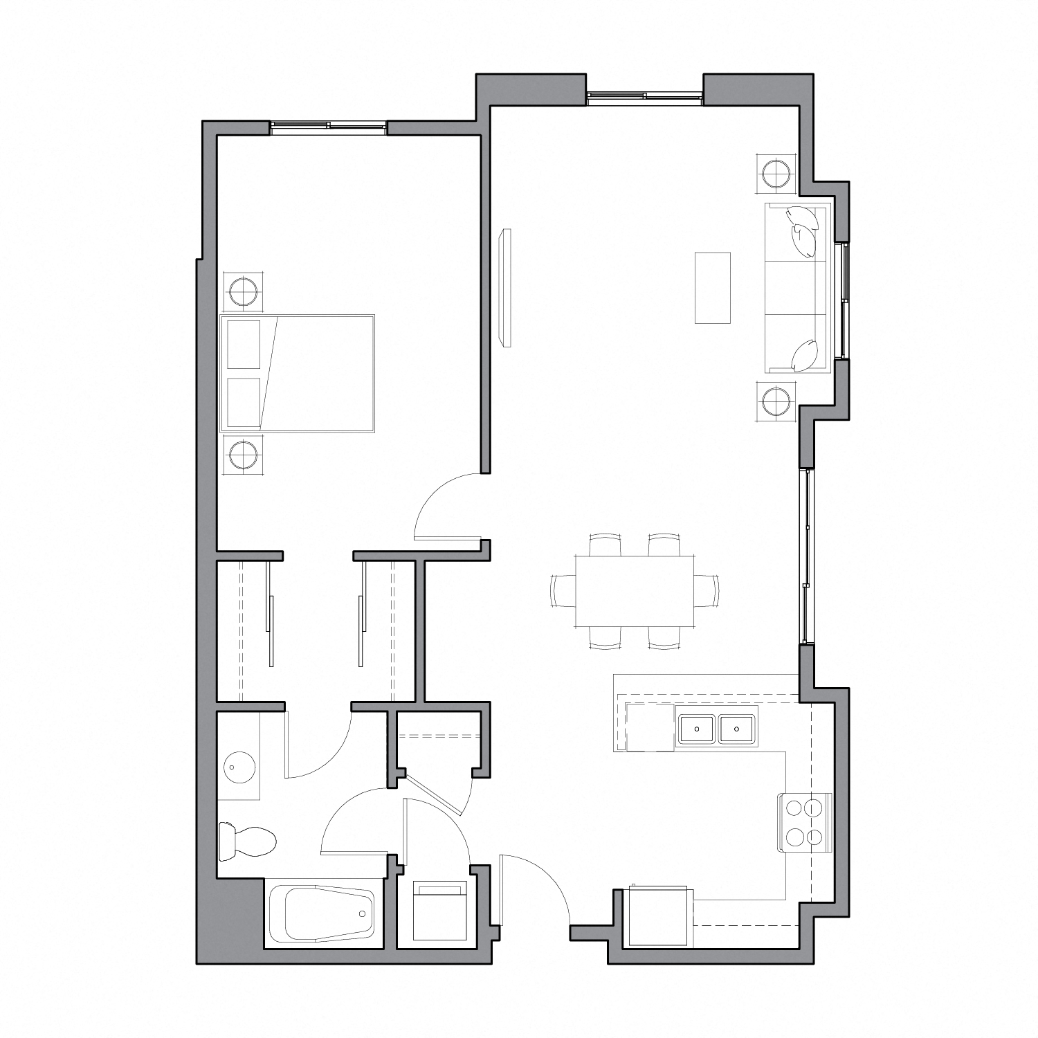 Floor plan diagram with one bedroom, one bathroom, and an open kitchen dining and living space