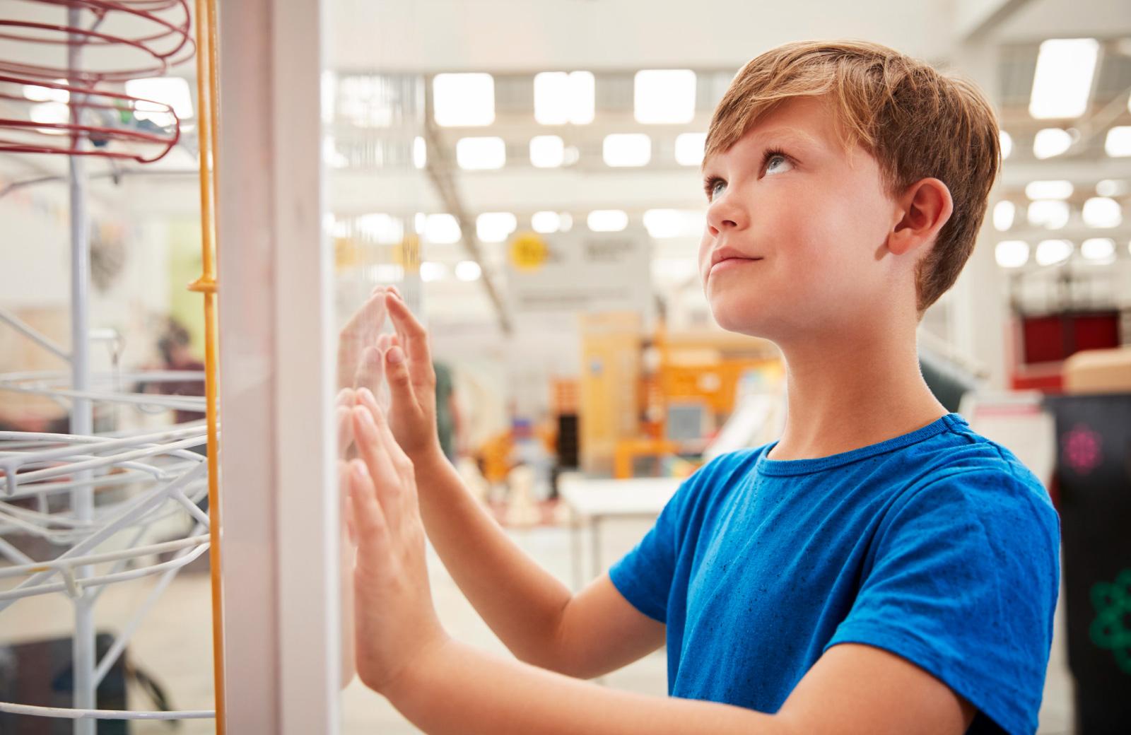 boy checking out an artwork