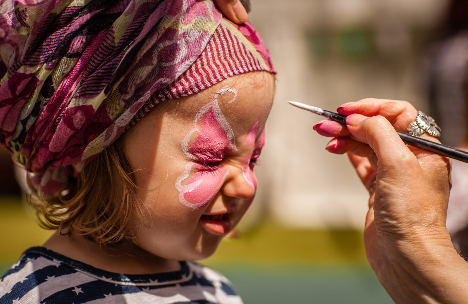 little girl getting face painted