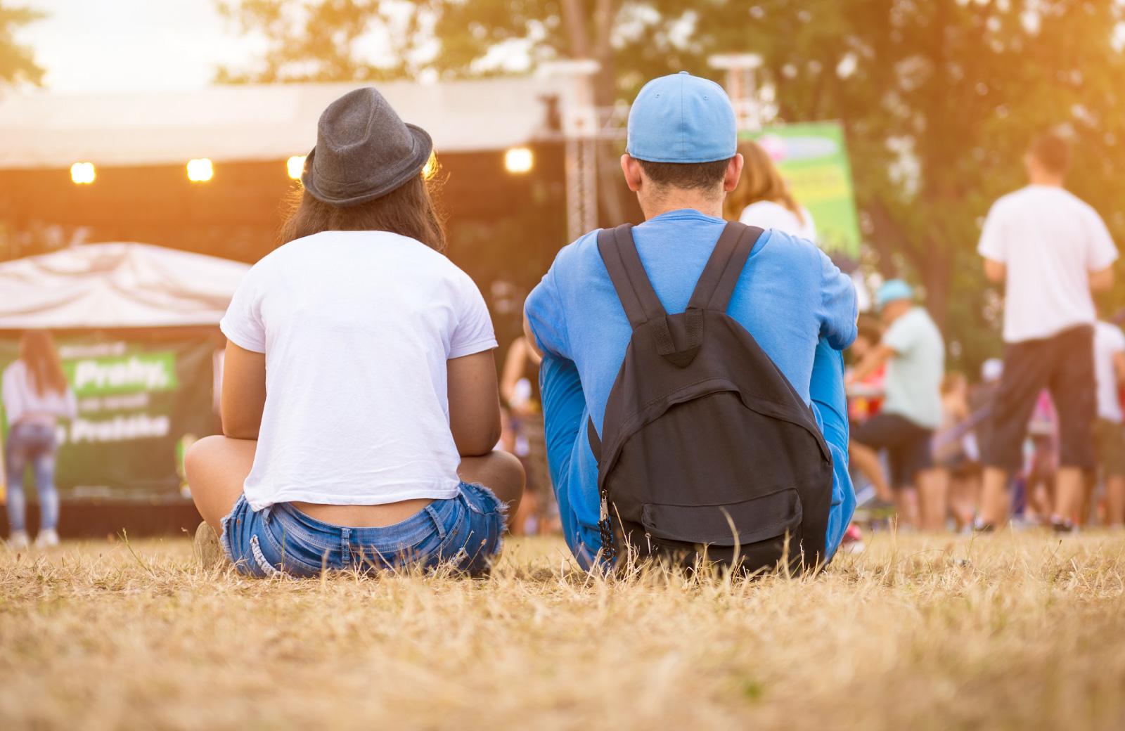 couple sitting on fair grounds
