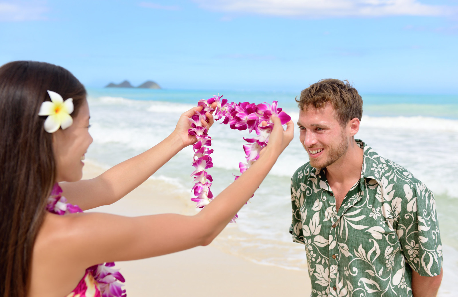 man receiving hawaiian lei