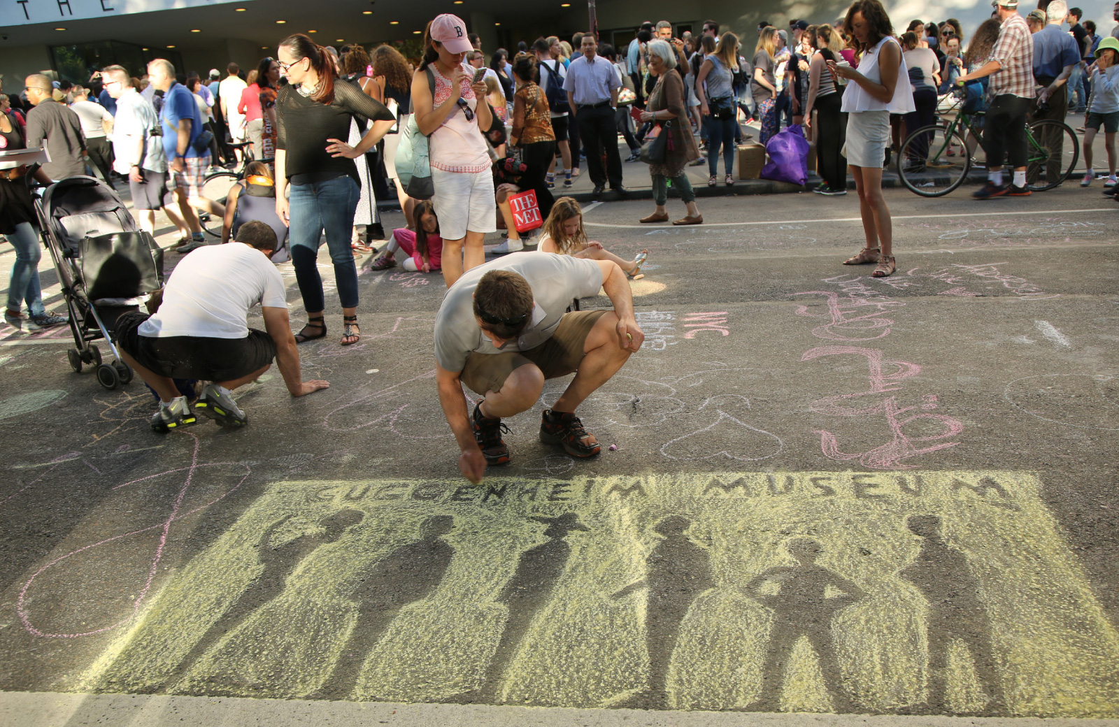 people creating street art for festival