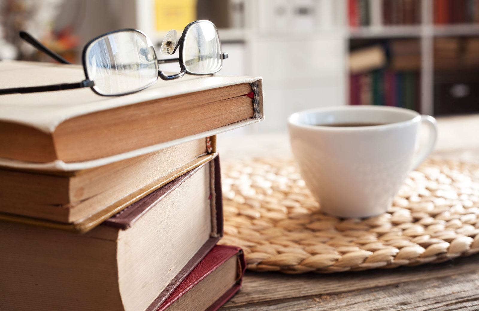 books eyeglasses and coffee on table